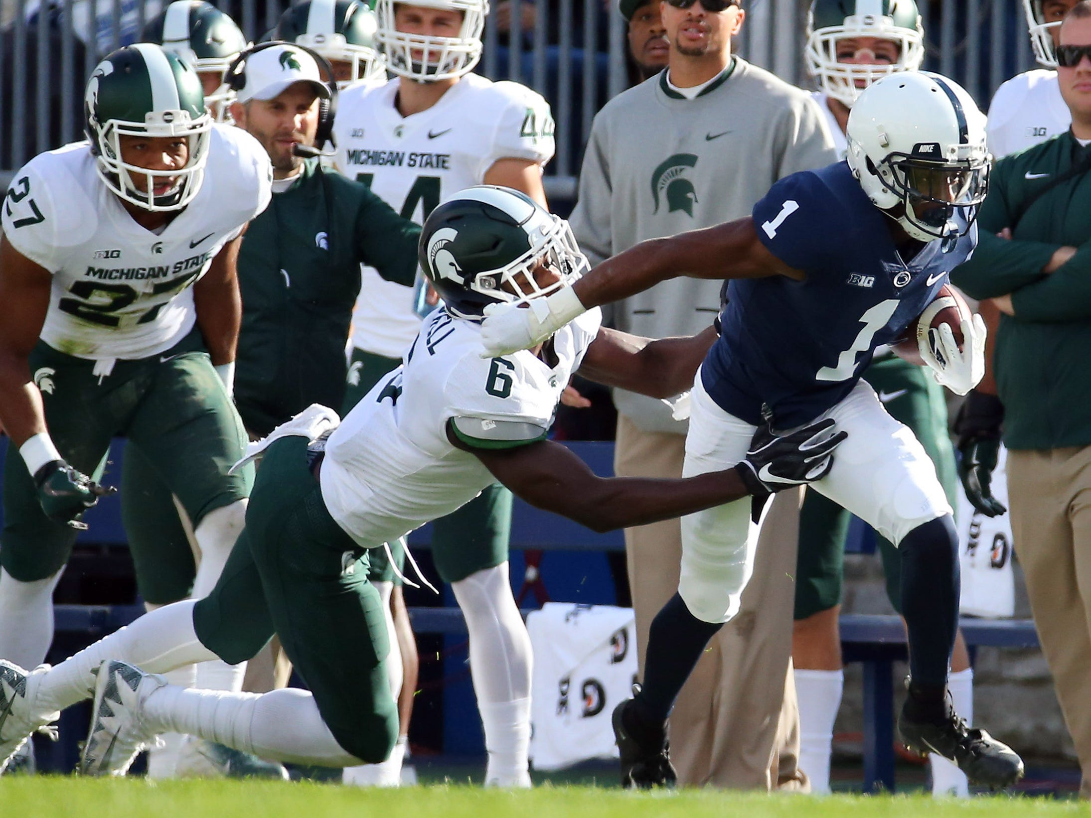 Penn State Nittany Lions wide receiver KJ Hamler (1) runs with the ball after a catch as Michigan State Spartans safety David Dowell (6) defends during the first quarter at Beaver Stadium.