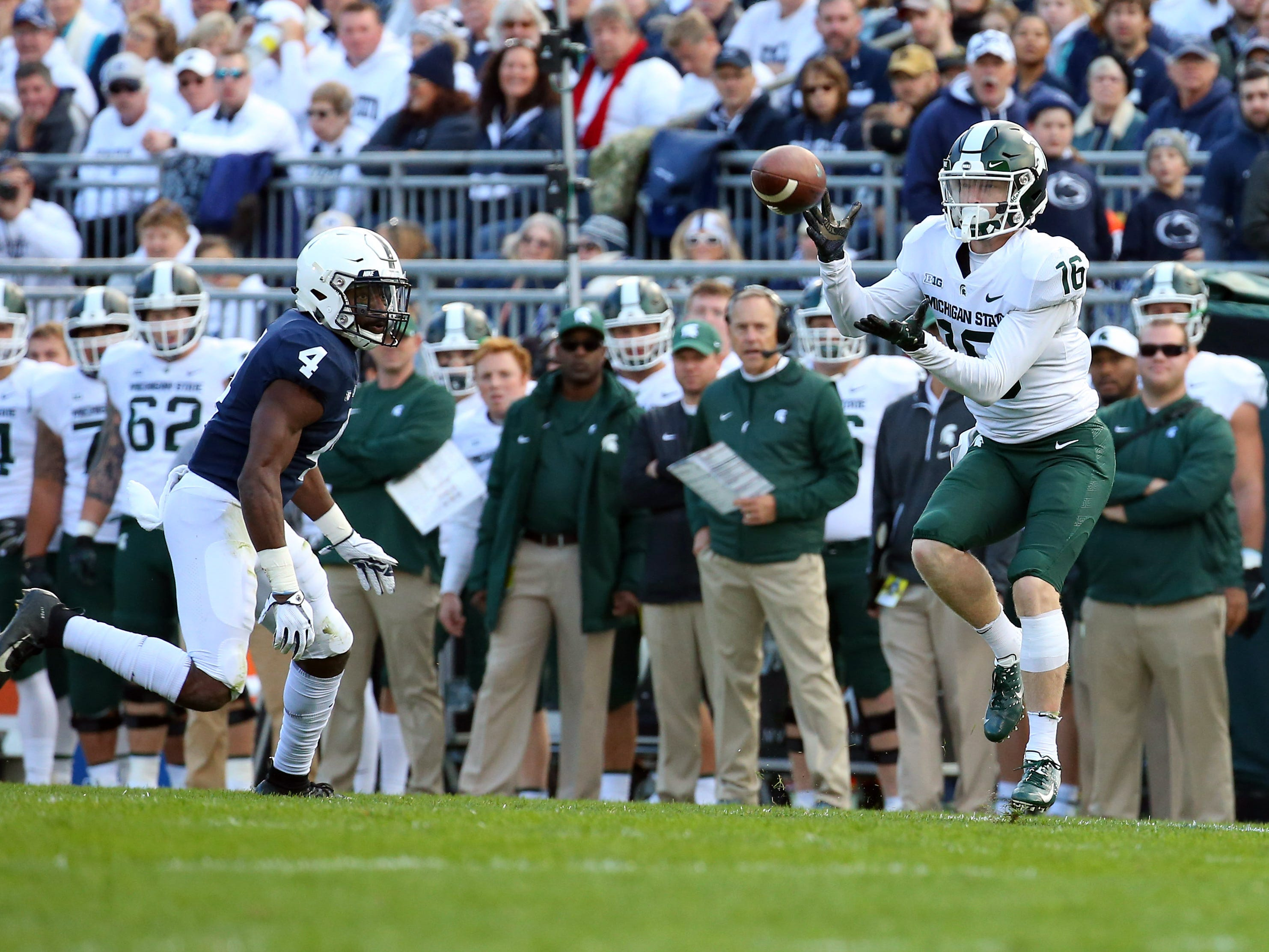 Michigan State Spartans wide receiver Brandon Sowards (16) catches a pass as Penn State Nittany Lions safety Nick Scott (4) defends during the first quarter at Beaver Stadium.