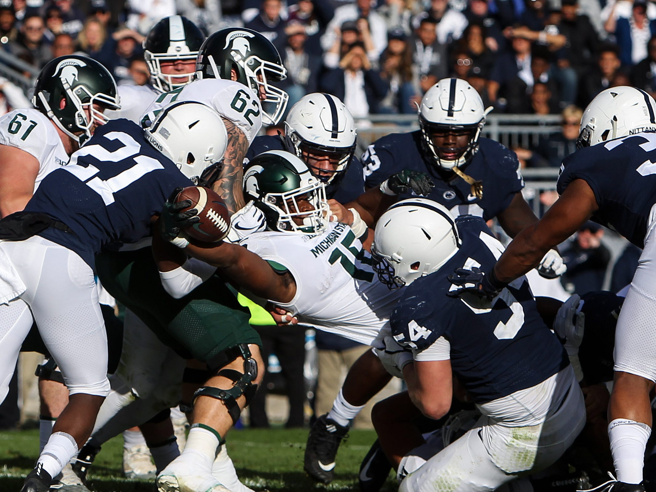 Michigan State Spartans running back La'Darius Jefferson (15) runs the ball into the end zone for a touchdown during the second quarter against the Penn State Nittany Lions at Beaver Stadium.