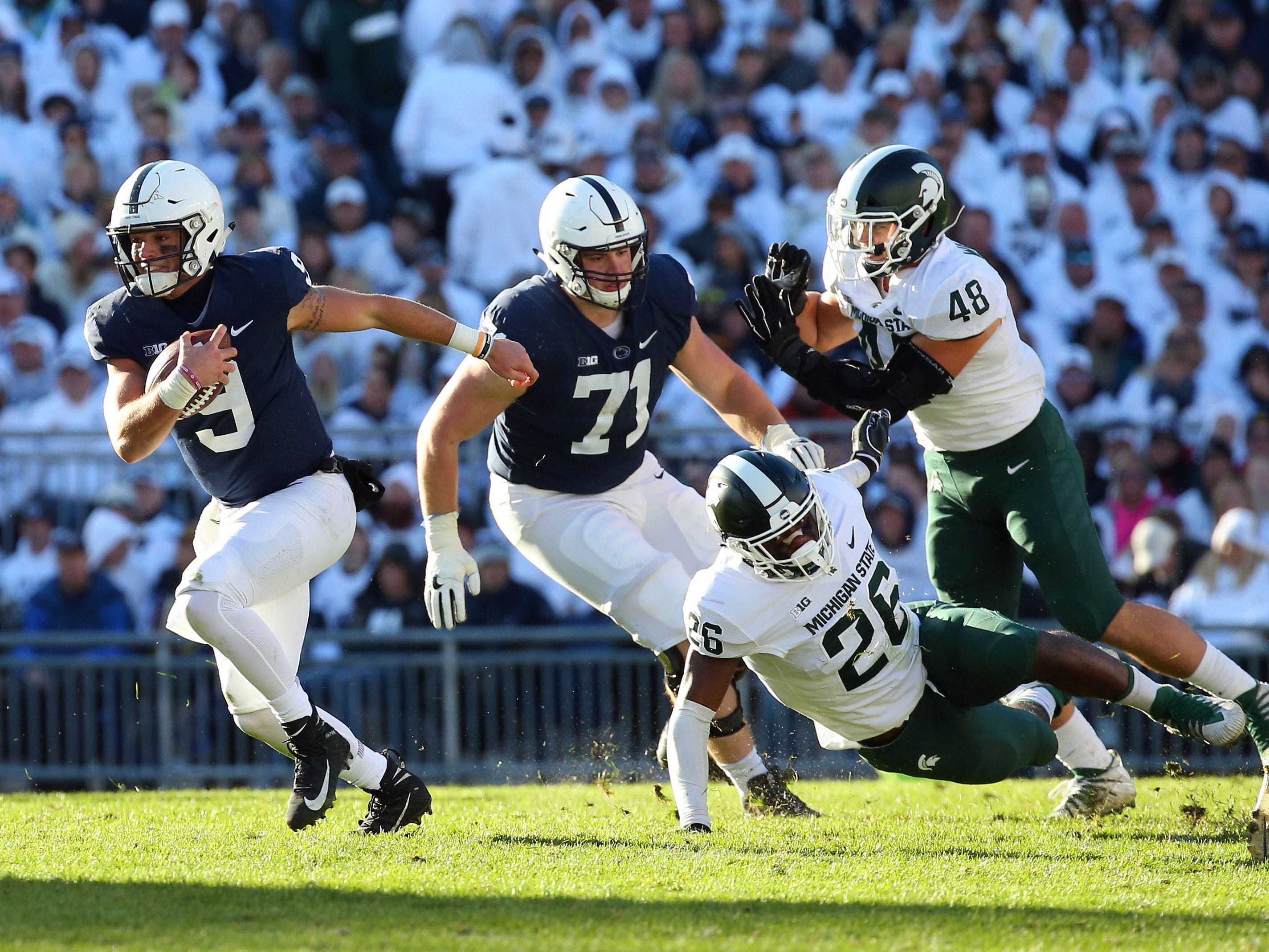 Penn State Nittany Lions quarterback Trace McSorley (9) runs with the ball against the Michigan State Spartans during the second quarter at Beaver Stadium.