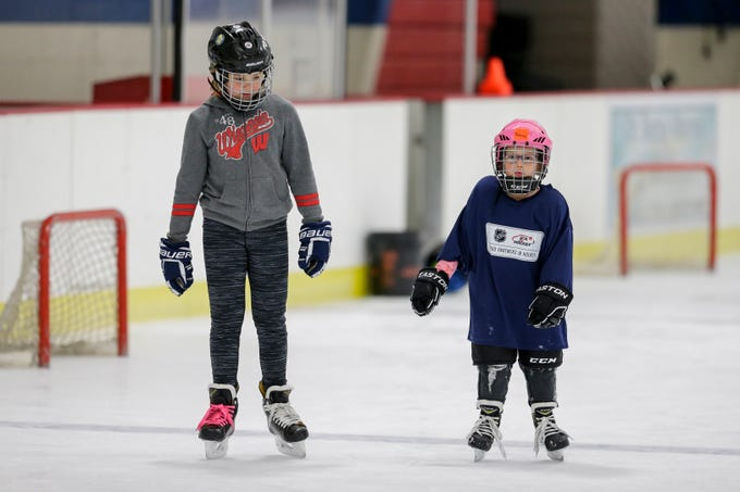 Amelia Suchomel, 9, skates with Reese Kalcich, 4, during the Girls Try Hockey event at the County Ice Center Saturday, October 13, 2018, in Manitowoc, Wis. Joshua Clark/USA TODAY NETWORK-Wisconsin