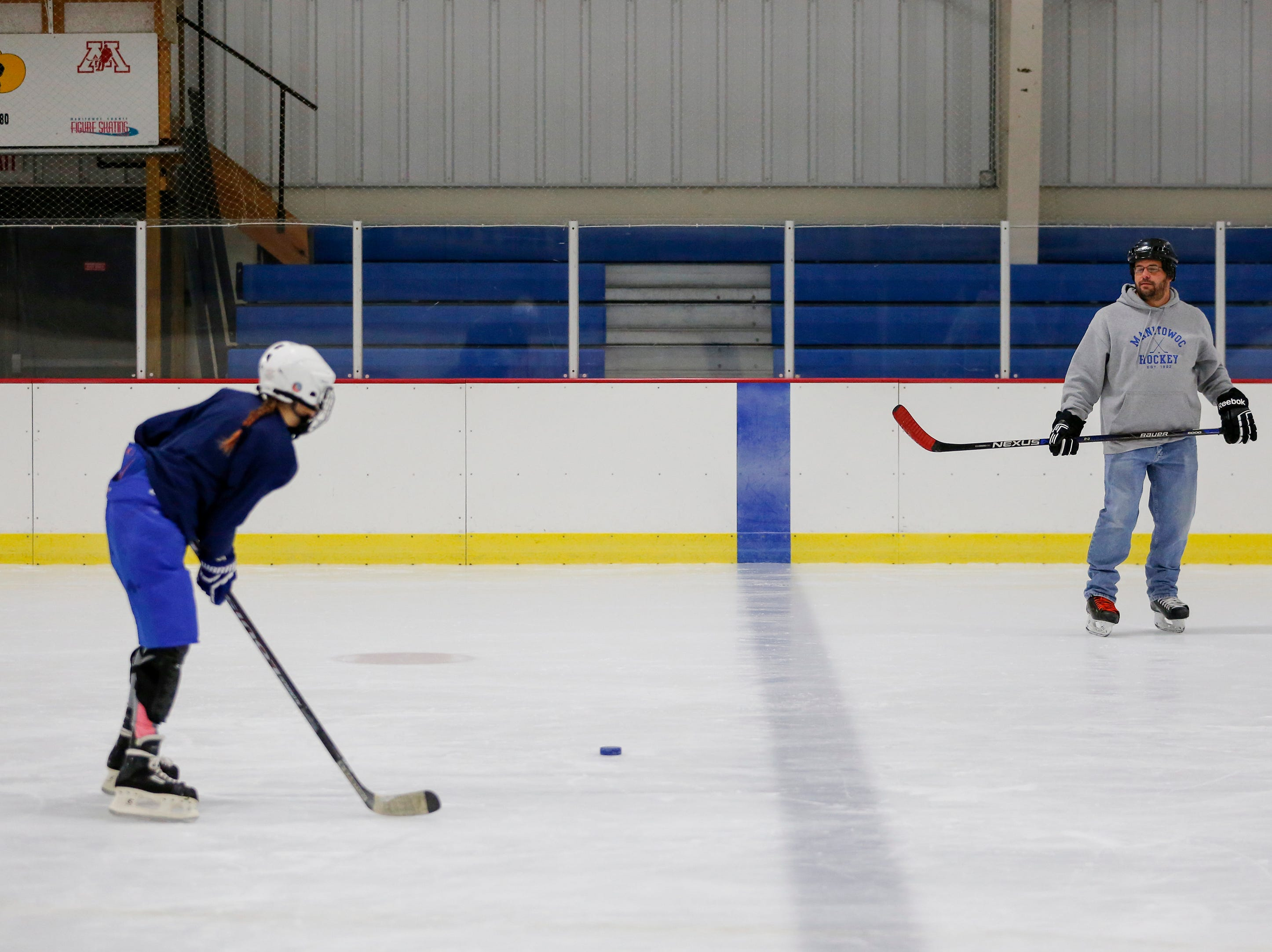 Shaelyn Gamble, 11, practices passing with coaching coordinator Rick Slearvin during the Girls Try Hockey event at the County Ice Center Saturday, October 13, 2018, in Manitowoc, Wis. Joshua Clark/USA TODAY NETWORK-Wisconsin