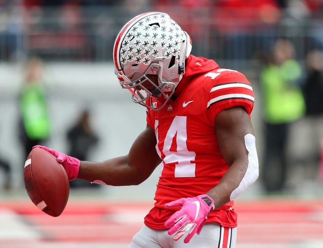 Ohio State wide receiver K.J. Hill celebrates his one-handed touchdown catch during the second quarter of Saturday's 30-14 win over Minnesota.