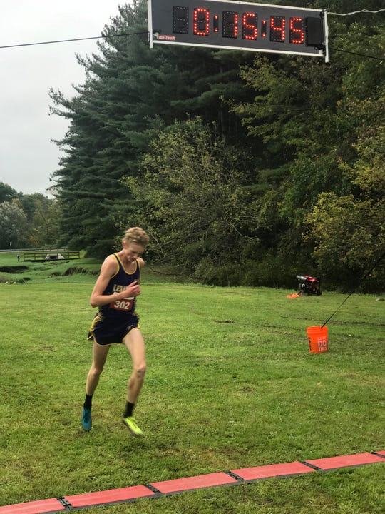 Lexington's Kyle Johnston crosses the finish line at the Ohio Cardinal Conference meet on Saturday in Ashland as the top individual runner of the day.