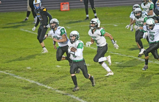 Clear Fork's Caden Flynn returns the opening kickoff back for a touchdown Friday night at Ontario High School during a game with the warriors.
