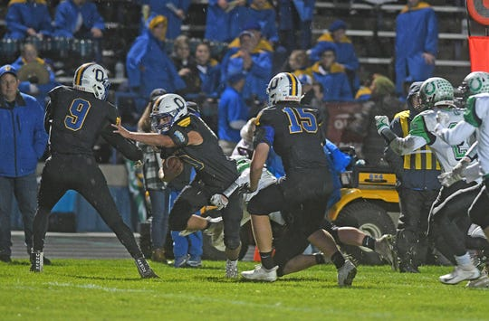 Ontario's Noah Creed finds room to run Friday night during a game with Clear Fork.