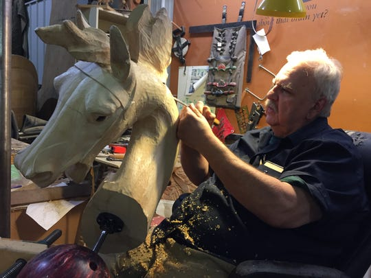 Art Ritchie works on a horse for a carousel in Greensborough, North Carolina.