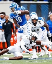 Memphis receiver Damonte Coxie scrambles past the Central Florida defense during action in Memphis, Tenn., Saturday, October 13, 2018.