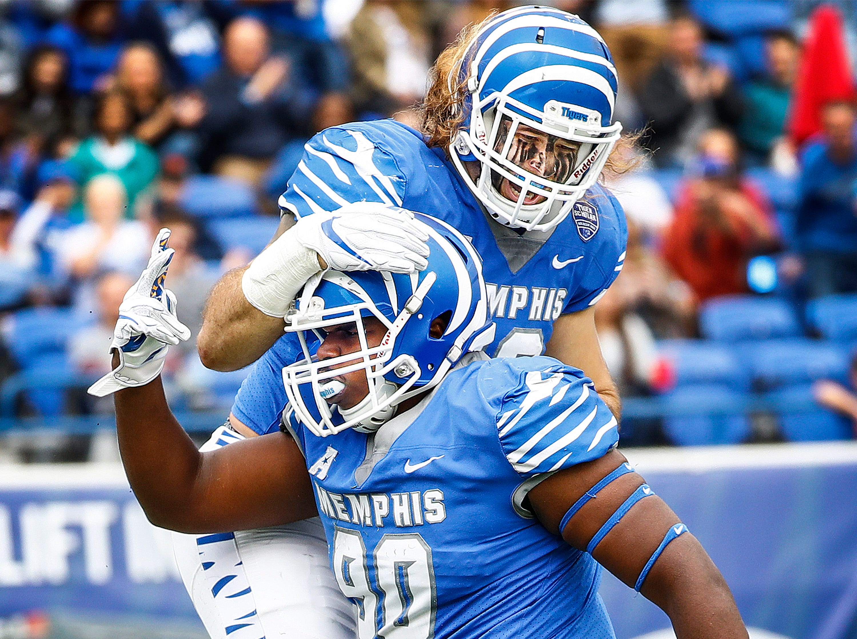 Memphis defender John Tate IV (bottom) celebrates his second sack with teammate Jonathan Wilson (top)Central Florida during action in Memphis, Tenn., Saturday, October 13, 2018.