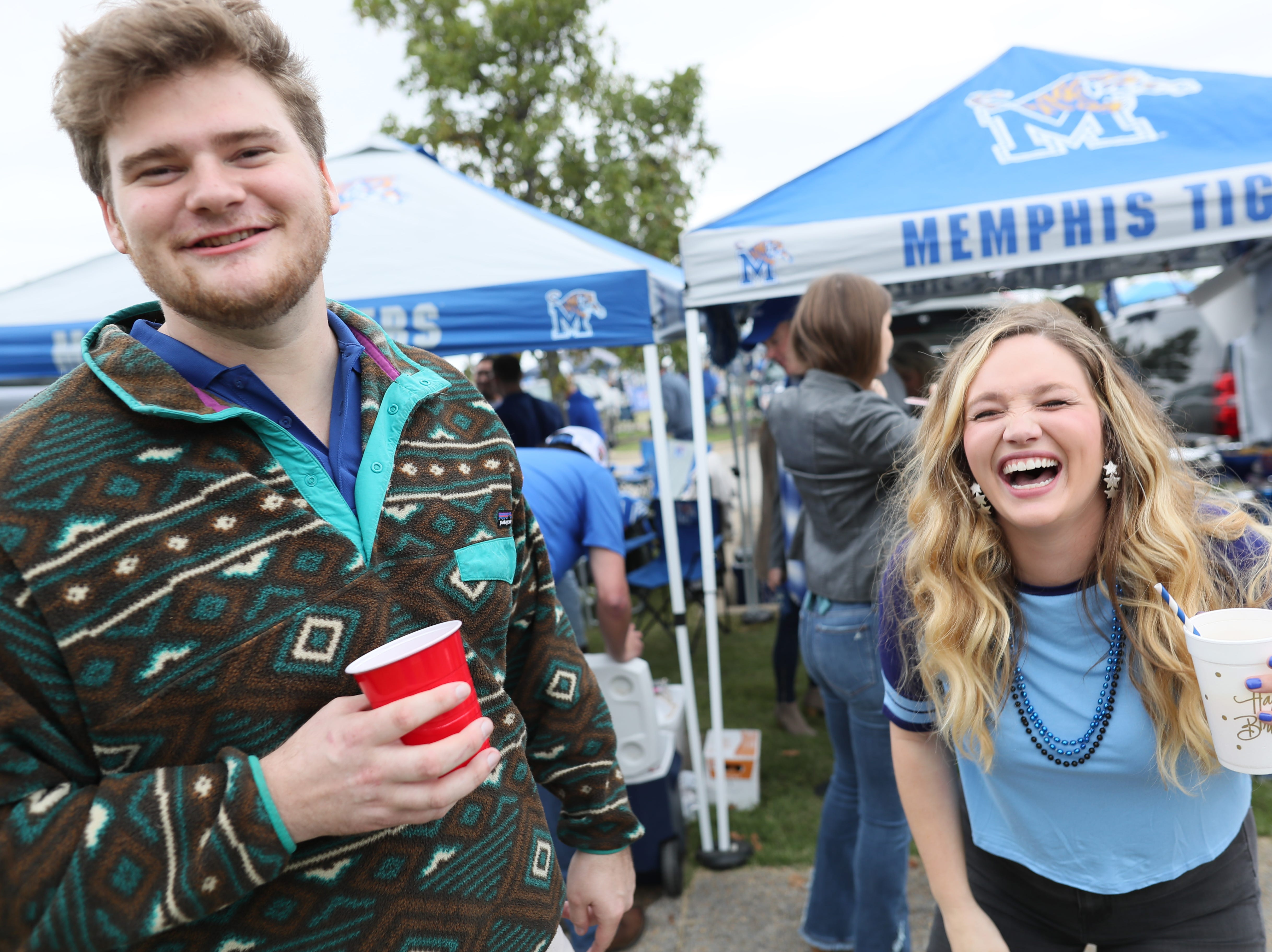 Zach Lyons and Hannah Deitz share a laugh as they tailgate before the Memphis Tigers's game against UCF at the Liberty Bowl on Saturday, Oct. 13, 2018.