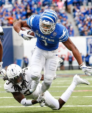 Memphis running back Tony Pollard fights for yards against Central Florida on Saturday.