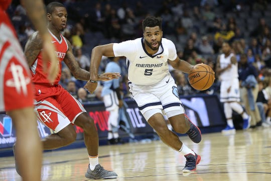 Memphis Grizzlies Andrew Harrison drives past Houston Rockets defender Gary Clark during preseason action at the FedExForum in Memphis on Oct. 12.