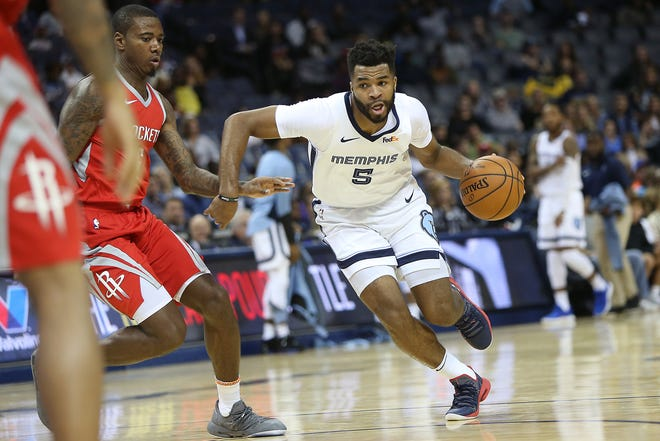 Grizzlies guard Andrew Harrison drives past Rockets defender Gary Clark during preseason action Oct. 12.