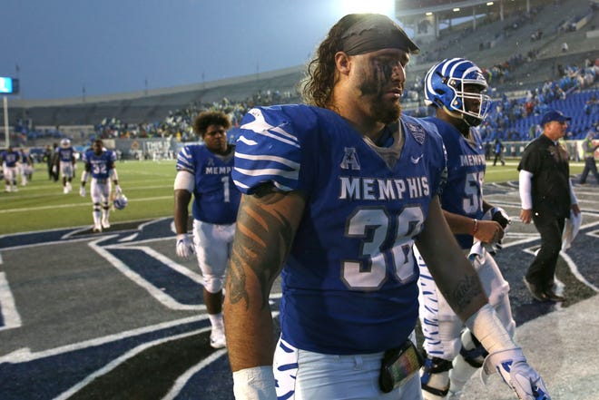 Memphis' Jonathan Wilson walks off the field after the Tigers heartbreaking 31-30 loss to UCF at the Liberty Bowl in Memphis, Tenn., Saturday, October 13, 2018.