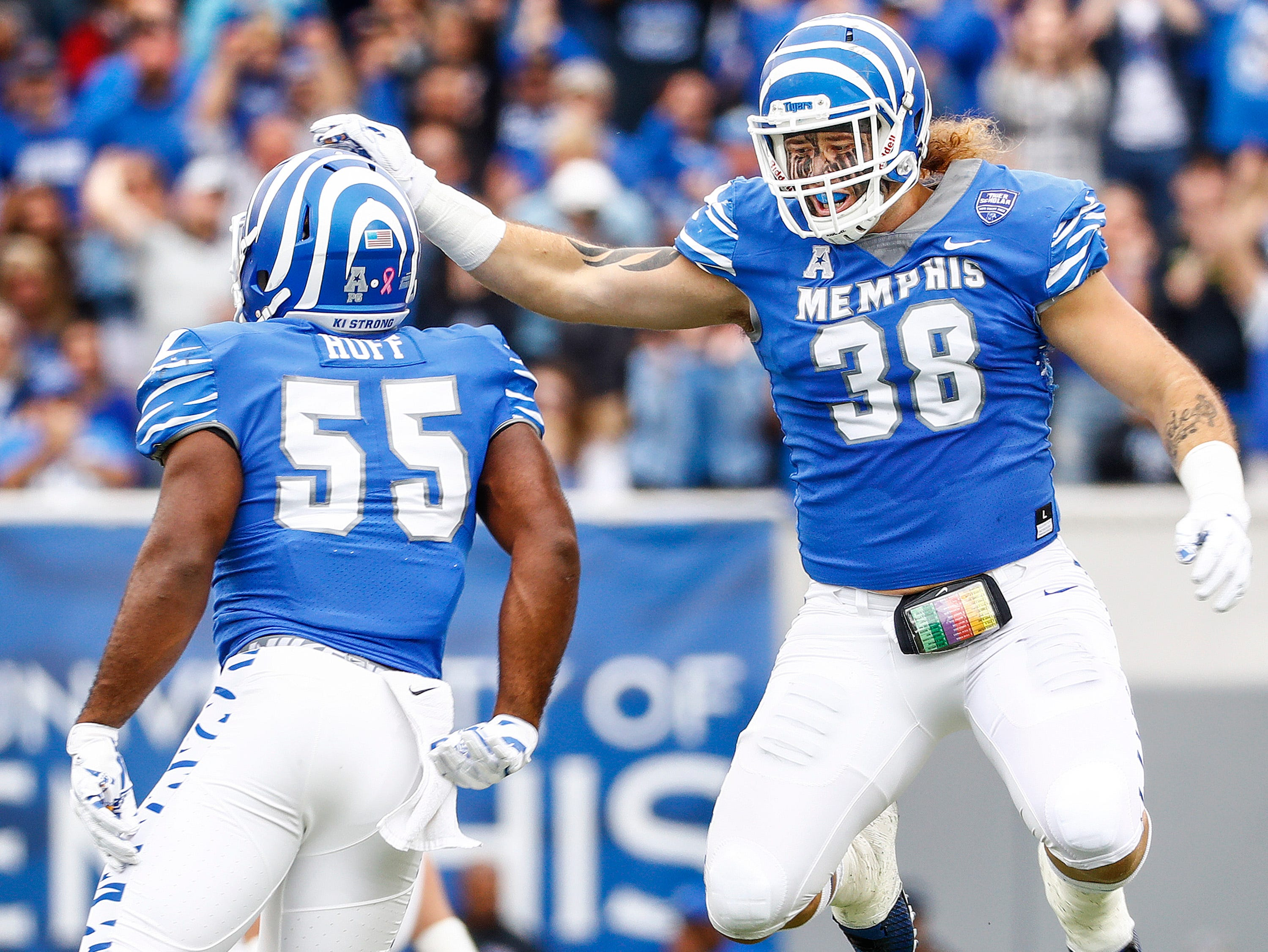 Memphis teammates Bryce Huff (left) and Jonathan Wilson celebrate a defense stop against Central Florida during action in Memphis, Tenn., Saturday, October 13, 2018.