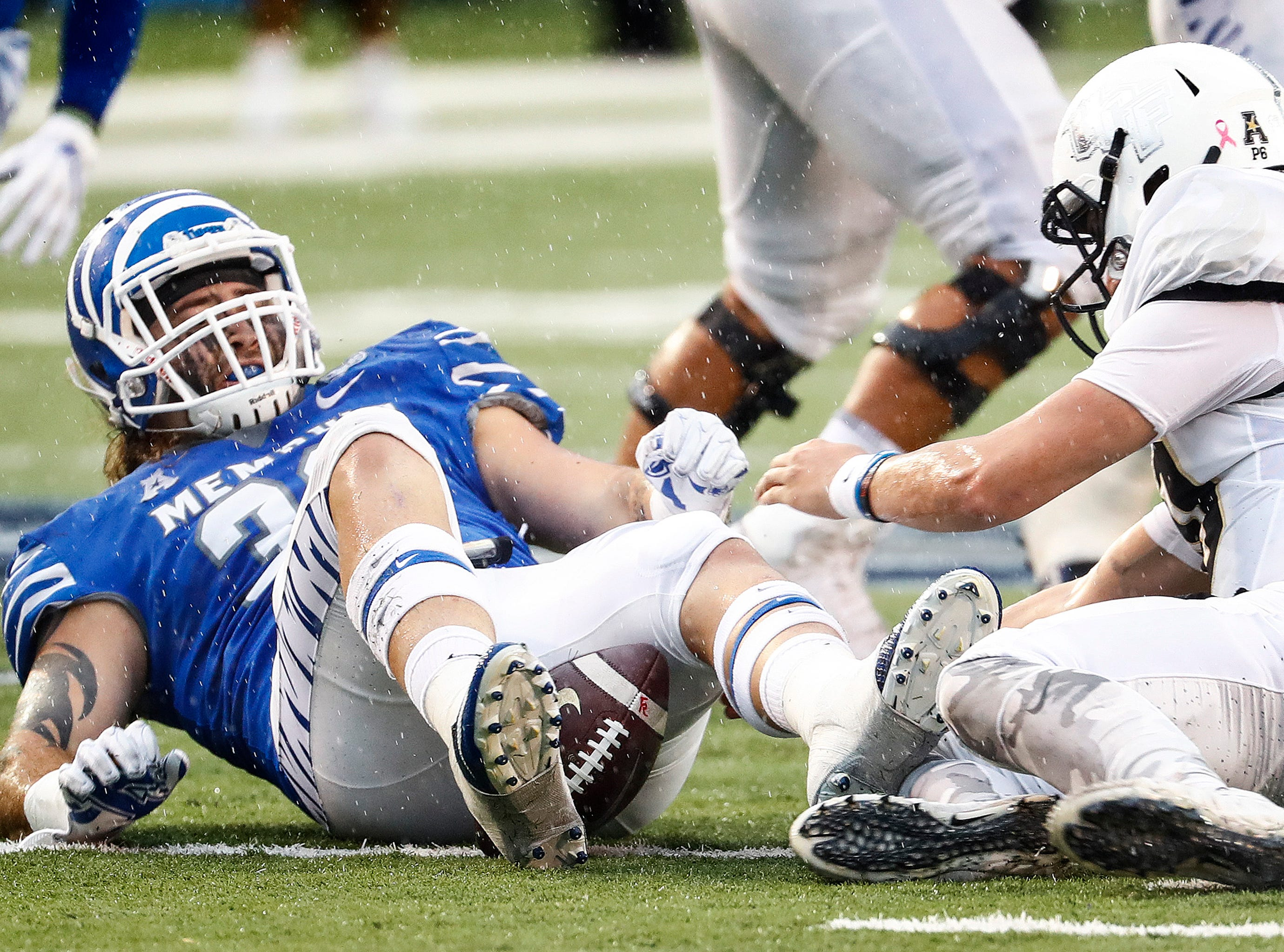 Memphis defender Jonathan Wilson (left) can not recover a Central Florida fumble during action in Memphis, Tenn., Saturday, October 13, 2018.