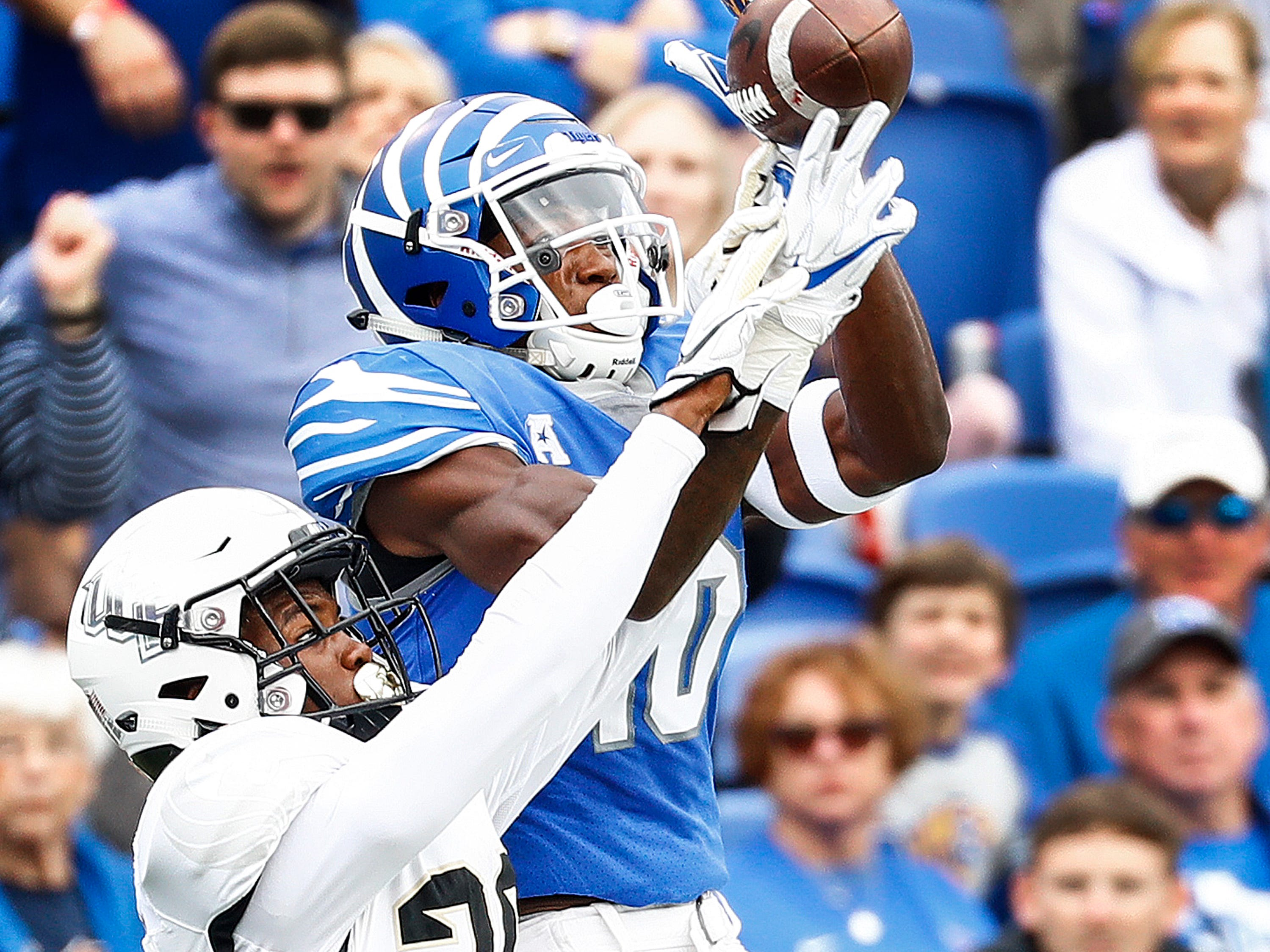Memphis receiver Damonte Coxie (right) can not hang onto a catch against Central Florida defender Brandon Moore (left) during action in Memphis, Tenn., Saturday, October 13, 2018.