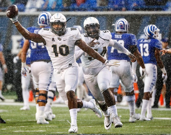 Central Florida defender Titus Davis celebrates a Memphis turnover in October. The two teams meet again in the AAC Championship game on Saturday.