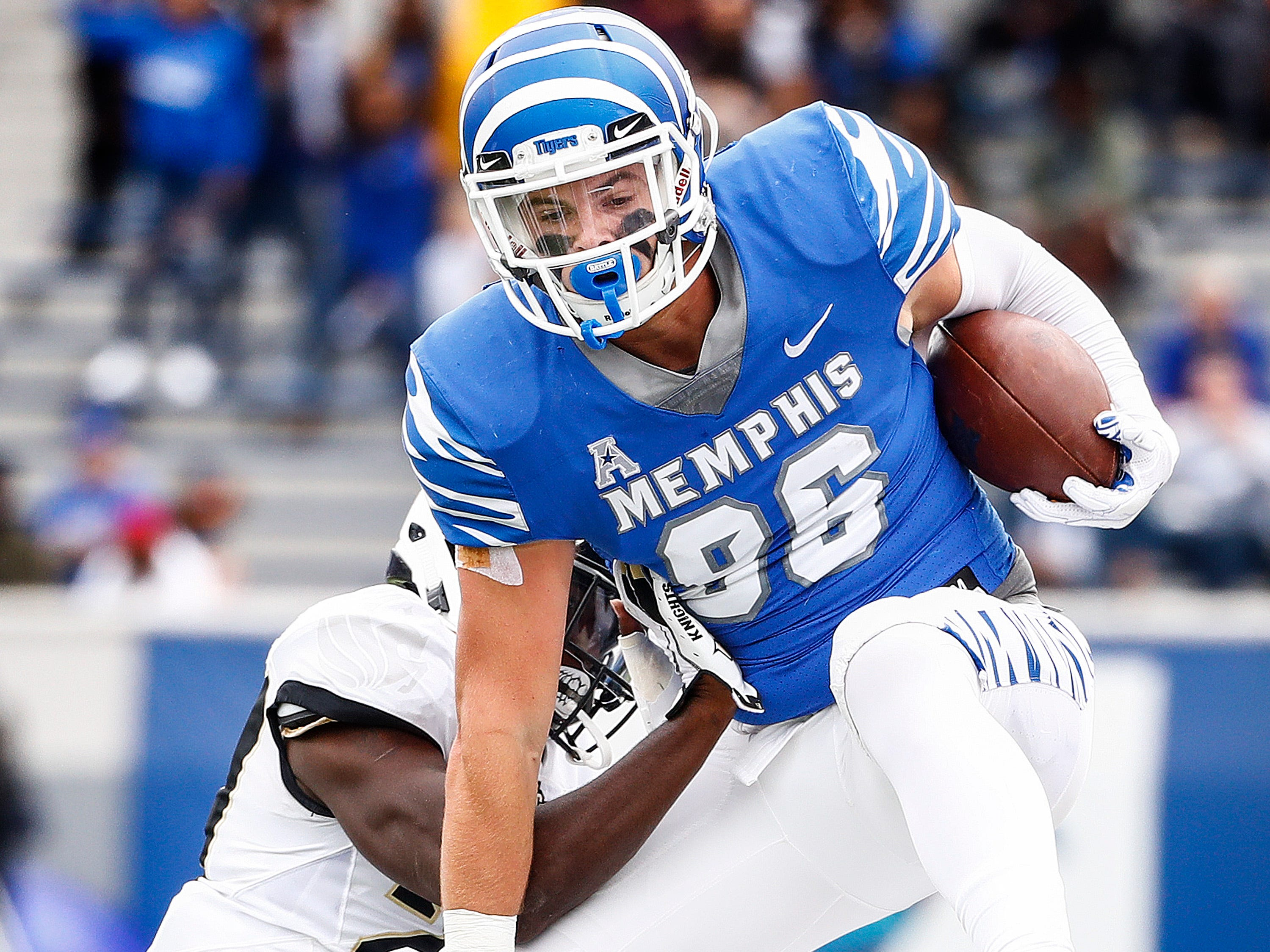 Memphis tight end Joey Magnifico (top) cups over the Central Florida defense during action in Memphis, Tenn., Saturday, October 13, 2018.