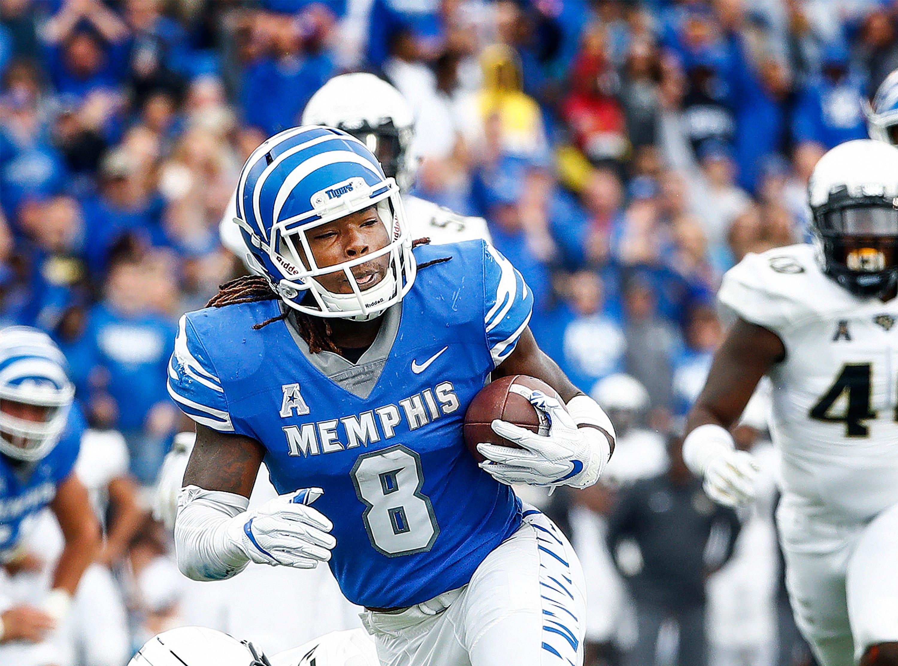 Memphis running back Darrell Henderson (top) runs past  Central Florida defender Kyle Gibson (bottom) for a touchdown during acton in Memphis, Tenn., Saturday, October 13, 2018.