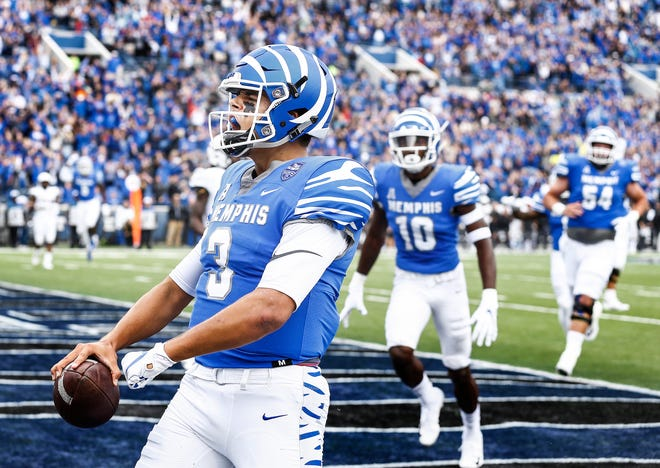 Memphis quarterback Brady White celebrates a rushing touchdown against Central Florida during action in Memphis, Tenn., Saturday, October 13, 2018.