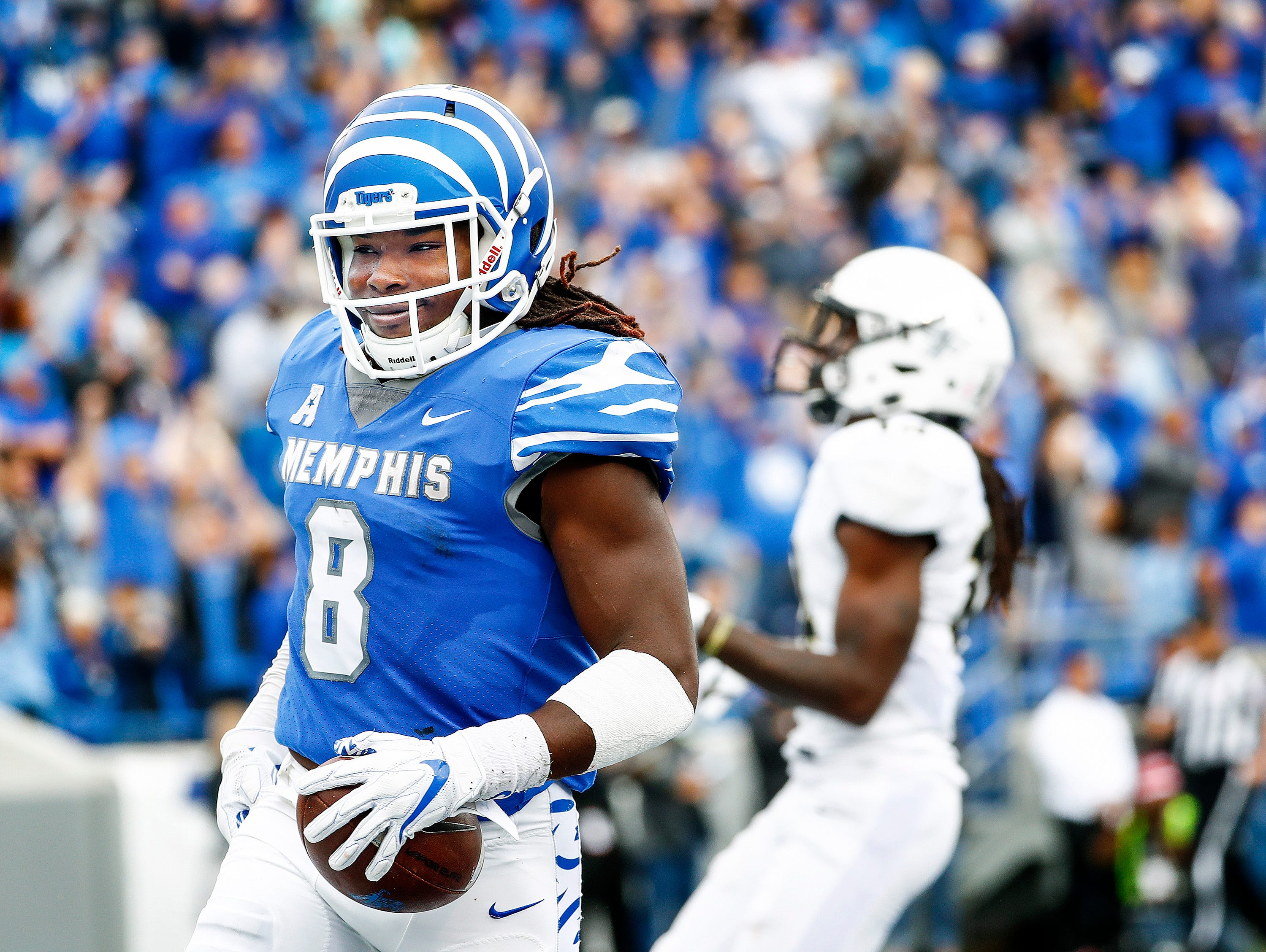 Memphis running back Darrell Henderson (left) celebrates a touchdown against the Central Florida defense during acton in Memphis, Tenn., Saturday, October 13, 2018.
