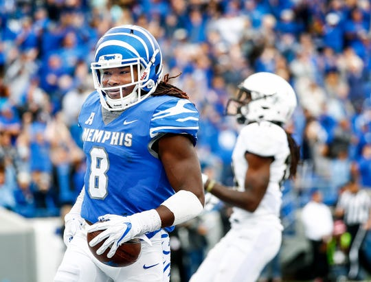 Memphis running back Darrell Henderson (left) celebrates a touchdown against Central Florida.