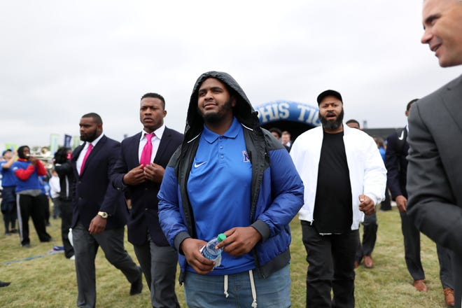 Tyler Smith, a heart transplant recipient and LeBonheur patient, leads the Memphis Tigers through the traditional Tiger Walk at the Liberty Bowl before their game against UCF on Saturday, Oct. 13, 2018.