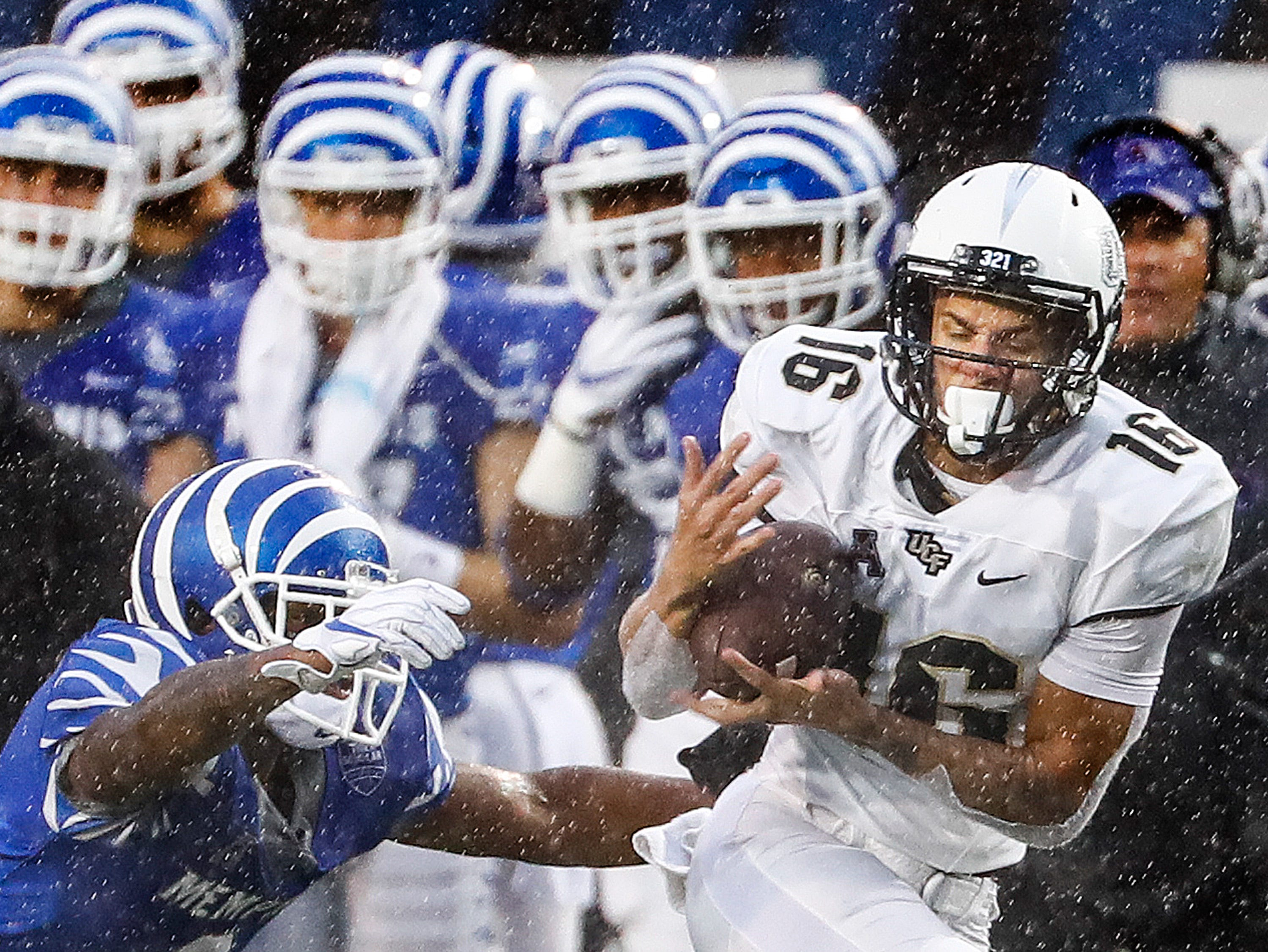 Central Florida receiver Tre Nixon (right) grabs a first down catch against Memphis during action in Memphis, Tenn., Saturday, October 13, 2018.