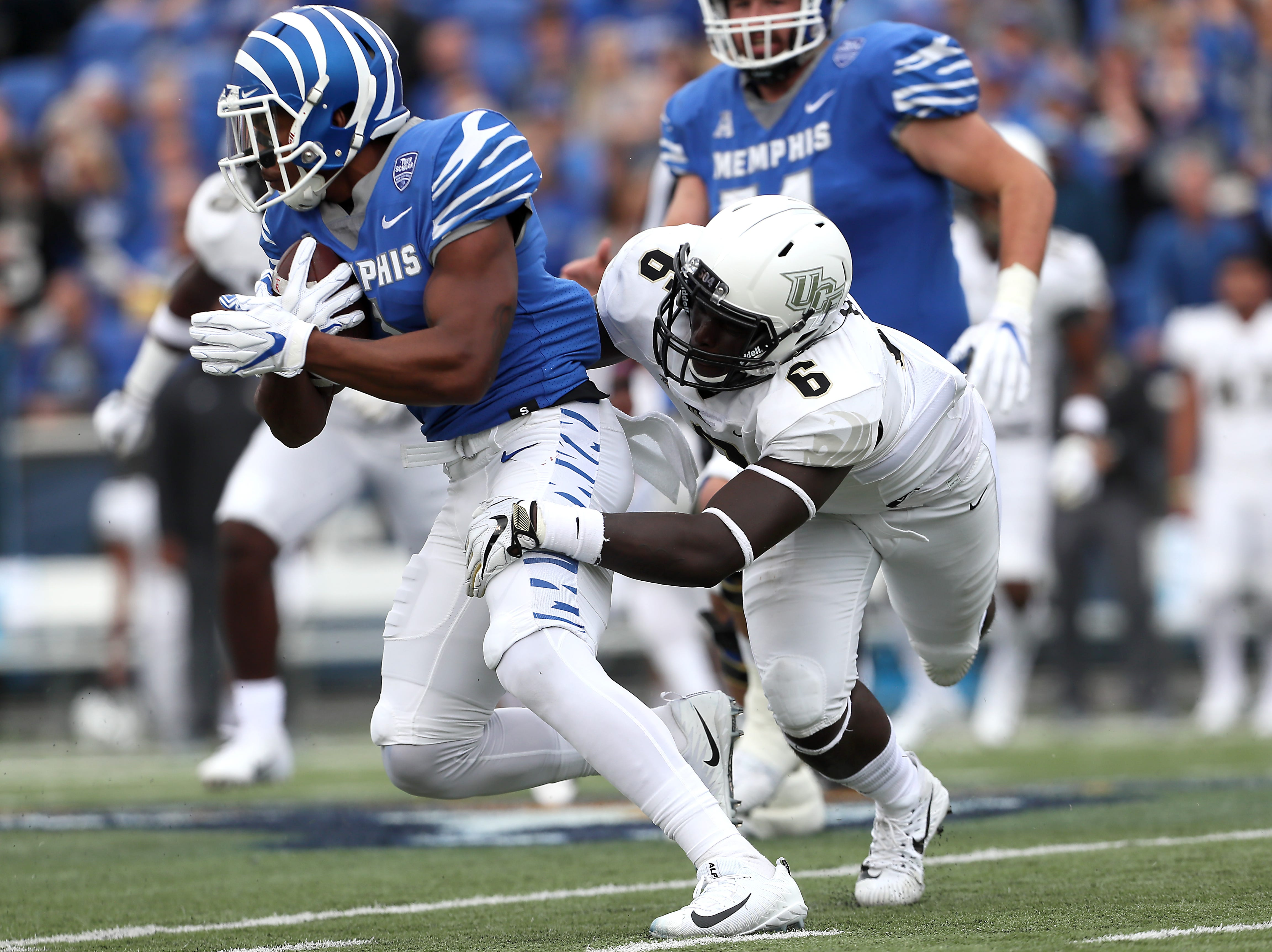 Memphis' Tony Pollard breaks away from UCF's Brendon Hayes during their game at the Liberty Bowl in Memphis, Tenn., Saturday, October 13, 2018.