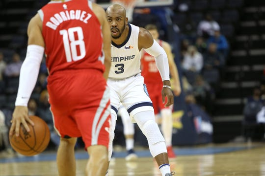 Jevon Carter defends the Rockets' Angel Rodriguez during a preseason game Oct. 12. Carter was impressive in his NBA regular-season debut against Houston on Saturday.