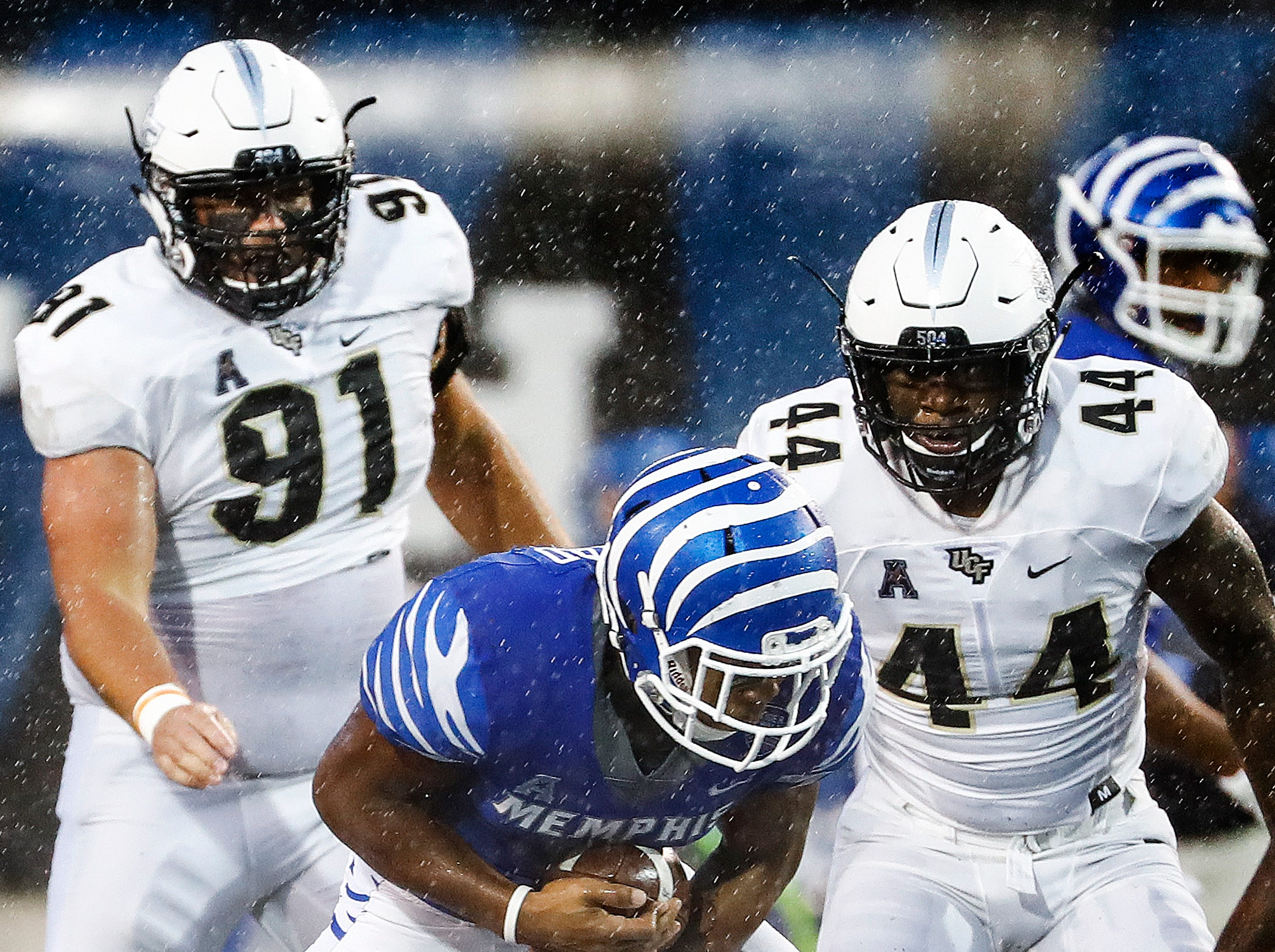 Memphis running back Tony Pollard fights for positive yards against the Central Florida defense during action in Memphis, Tenn., Saturday, October 13, 2018.