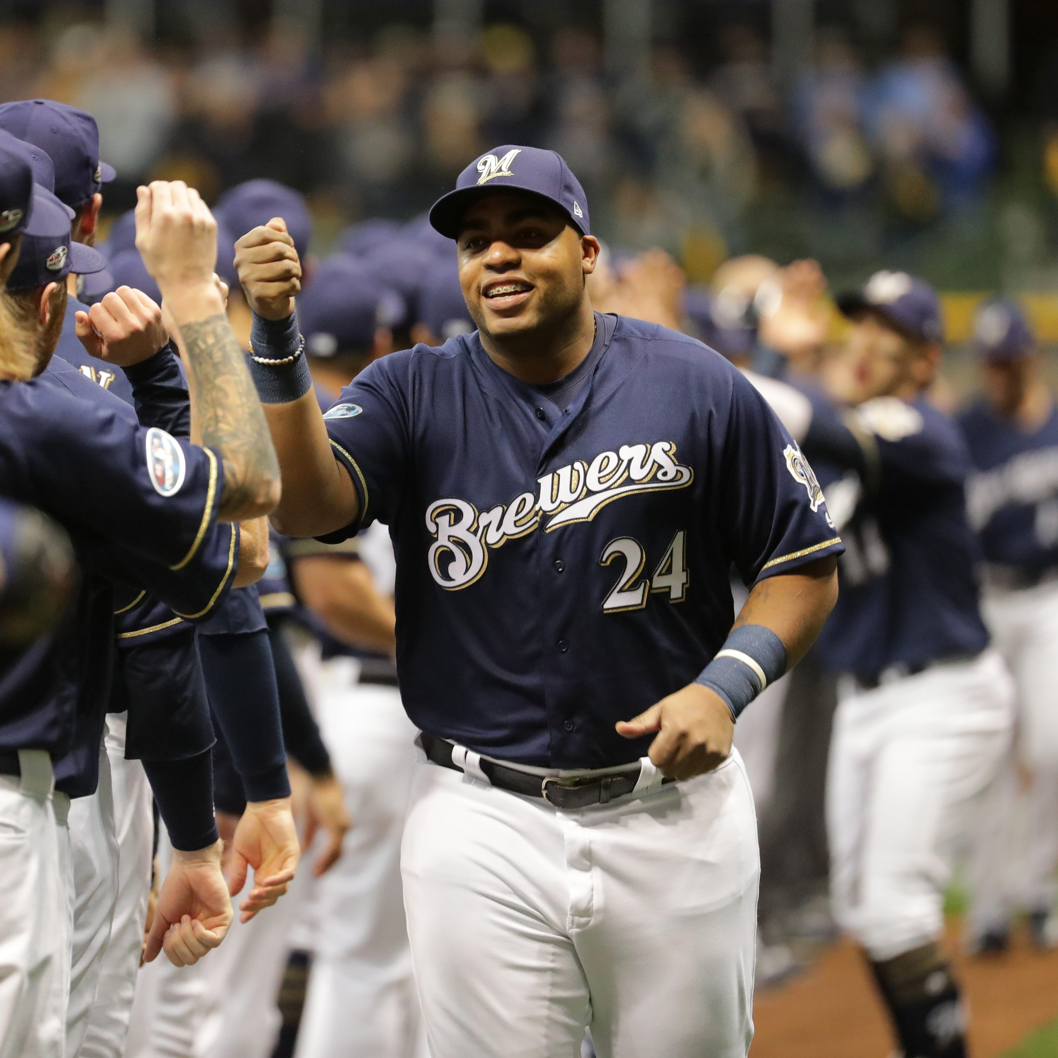 Jesus Aguilar tips his cap for someone else's standing ovation as Wade Miley leaves game Saturday