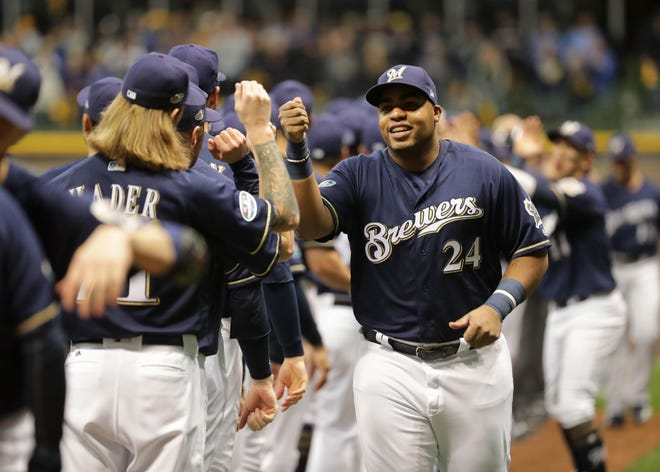 Brewers first baseman Jesus Aguilar is introduced during pregame ceremonies before Game 1 against the Dodgers on Friday night at Miller Park.