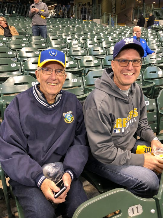 Don Kneiert (left) is celebrating his 80th birthday with his son Jeff Kneiert by watching the Brewers play the Los Angeles Dodgers in the first game of the NLCS Oct. 12, 2018.