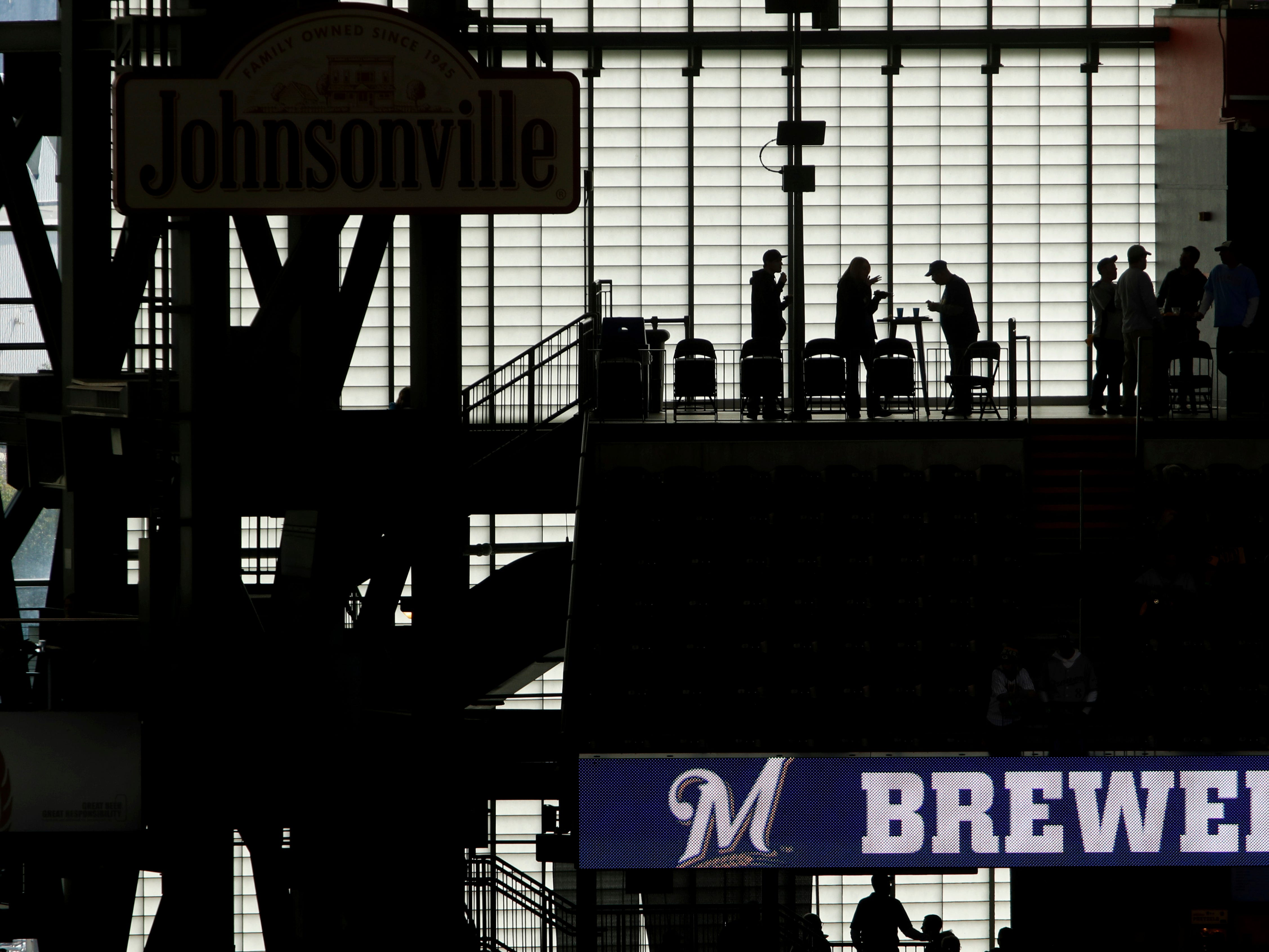 Fans arrive at Miller Park before Game 2 of the National League Championship Series baseball game Saturday between the Milwaukee Brewers and the Los Angeles Dodgers.