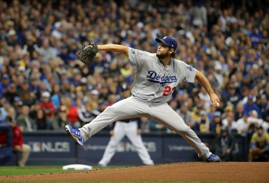 Dodgers ace Clayton Kershaw gets ready to unleash a pitch against the Brewers during Game 1 of the NLCS on Friday night at Miller Park.
