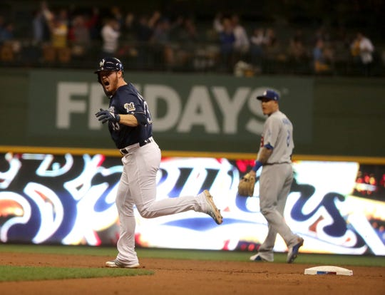 A pumped up Brandon Woodruff of the Brewers makes his tour of the bases after hitting a solo homer against the Dodgers in Game 1 of the NLCS on Friday night at Miller Park.