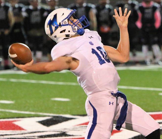 Mukwonago quarterback Justin Peck winds up for a deep pass.