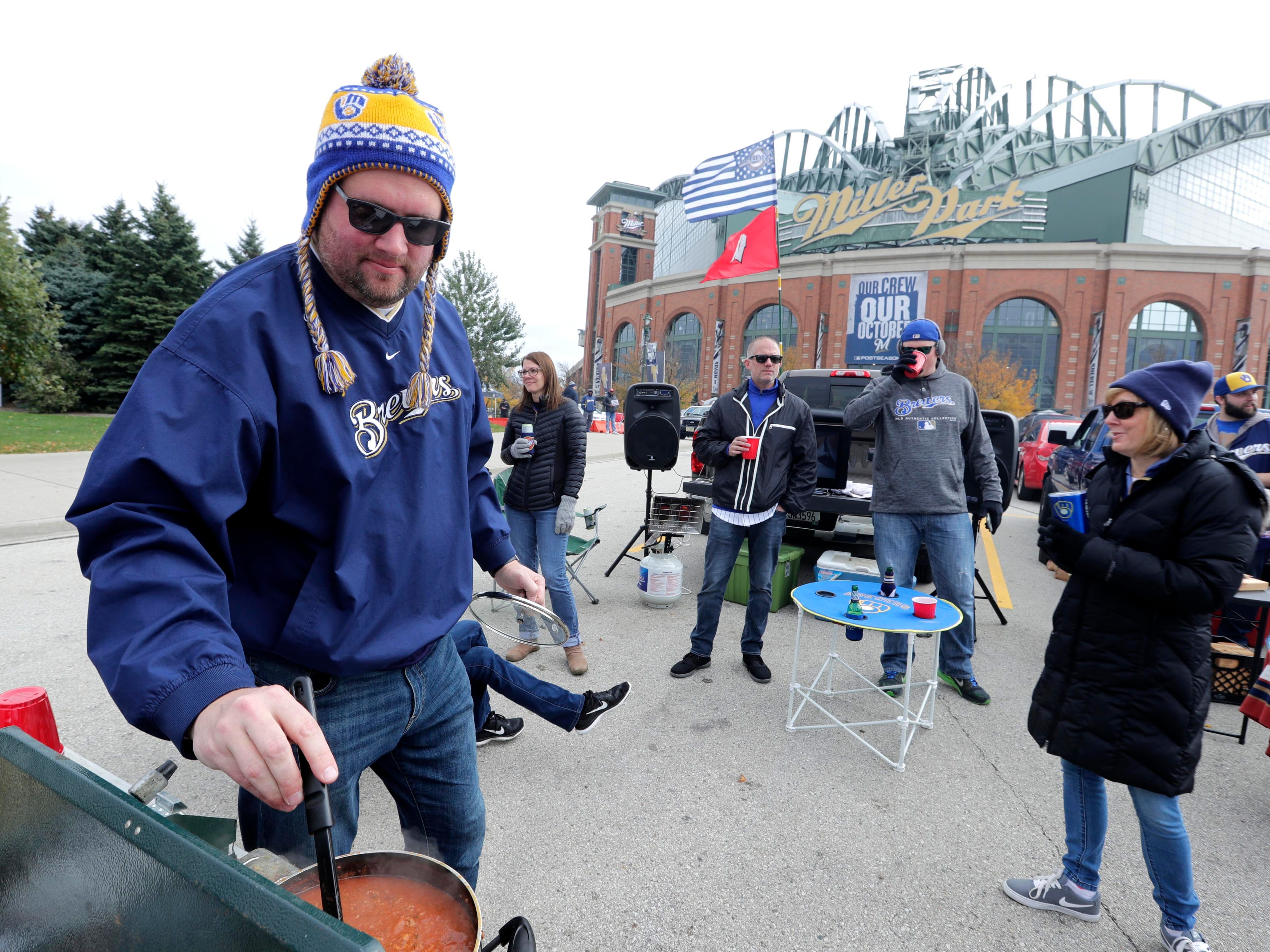Chad Strelow of Menonomee Falls checks on his playoff chili before the game.