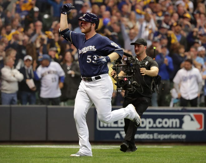 Brandon Woodruff heads back the dugout after hitting a solo homer against the Dodgers to tie Game 1 of the NLCS for the Brewers at 1-all.