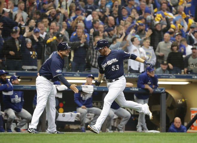 Milwaukee Brewers relief pitcher Brandon Woodruff (53) runs the bases after hitting a home run in the third inning. The Brewers play the Los Angeles Dodgers in Game 1 of the National League Championship Series baseball game Friday, October 12, 2018 at Miller Park in Milwaukee, Wis.   MARK HOFFMAN/MILWAUKEE JOURNAL SENTINEL ORG XMIT: MJS1810122012375836