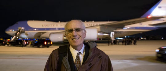 Milwaukee Journal Sentinel reporter Don Walker finishes his day as the local pool reporter while Air Force One gets ready to depart with President Obama in 2014. MARK HOFFMAN/MHOFFMAN@JOURNALSENTINEL.COM