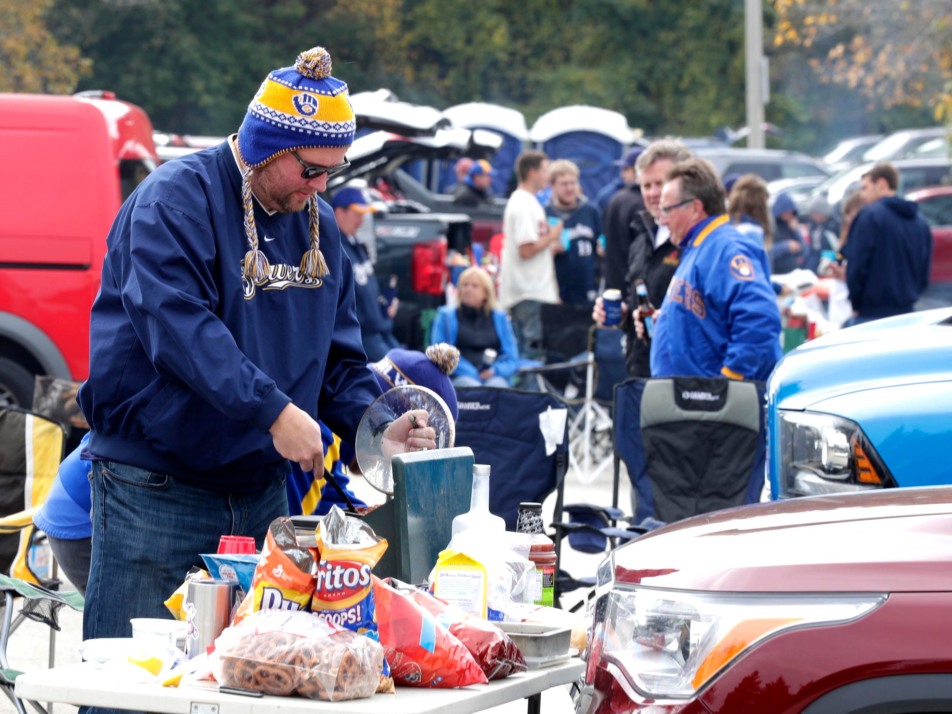 Chad Strelow of Menonomee Falls makes his favorite batch of playoff chili before the game.