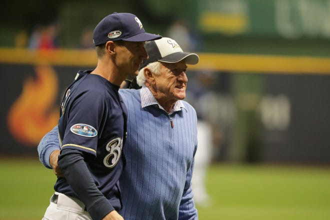 Bob Uecker and manager Craig Counsell walk off the field after the legendary Brewers radio announcer threw out the first pitch prior to Game 1 of the NLCS on Friday at Miller Park.