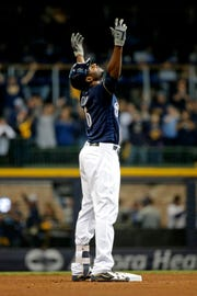 Lorenzo Cain of the Brewers gestures after hitting a double against the Dodgers in the fifth inning of Game 2 of the NLCS on Saturday.
