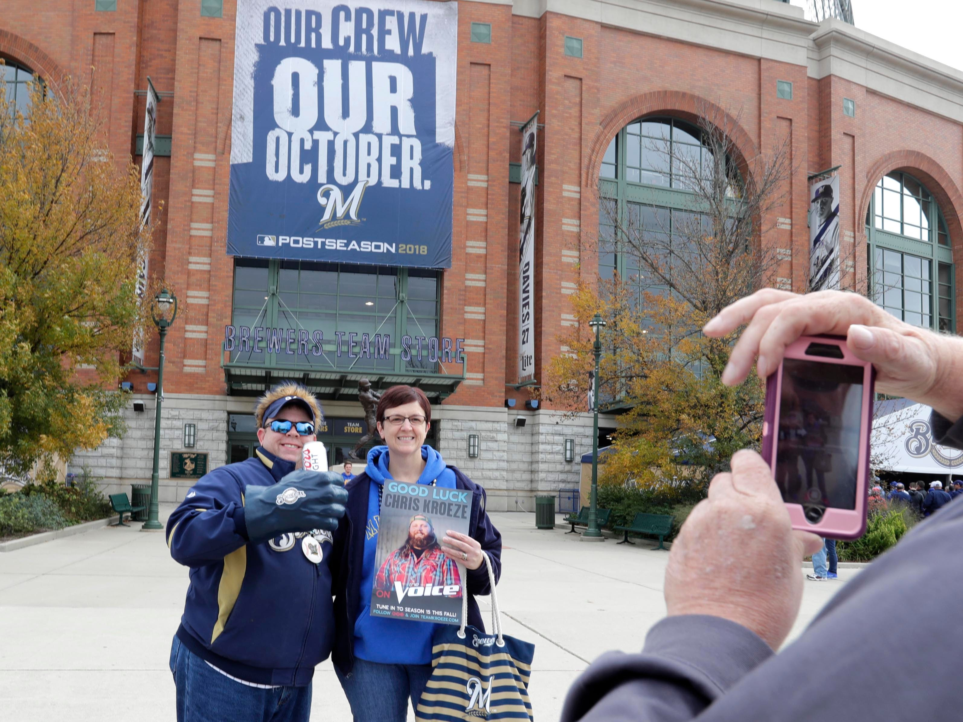 Randy Spiehs and Jodi from Barron take a photo outside Miller Park before the game Saturday between the Milwaukee Brewers and Los Angeles Dodgers.