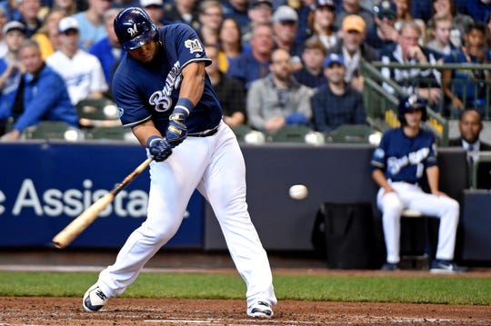 Brewers first baseman Jesus Aguilar gets ready to drill a single to left field against the Dodgers during the fourth inning of Game 2 on Saturday.