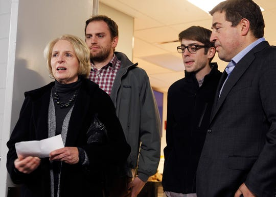 Sue Walker, widow of the late Milwaukee Journal Sentinel reporter Don Walker, speaks at the Fiserv Forum where the new media center was dedicated in his honor Friday. Walker had reported on the early stages of the project before his death in 2015. Also pictured are her sons Tim (left) and Peter, and Milwaukee Bucks President Peter Feigin.