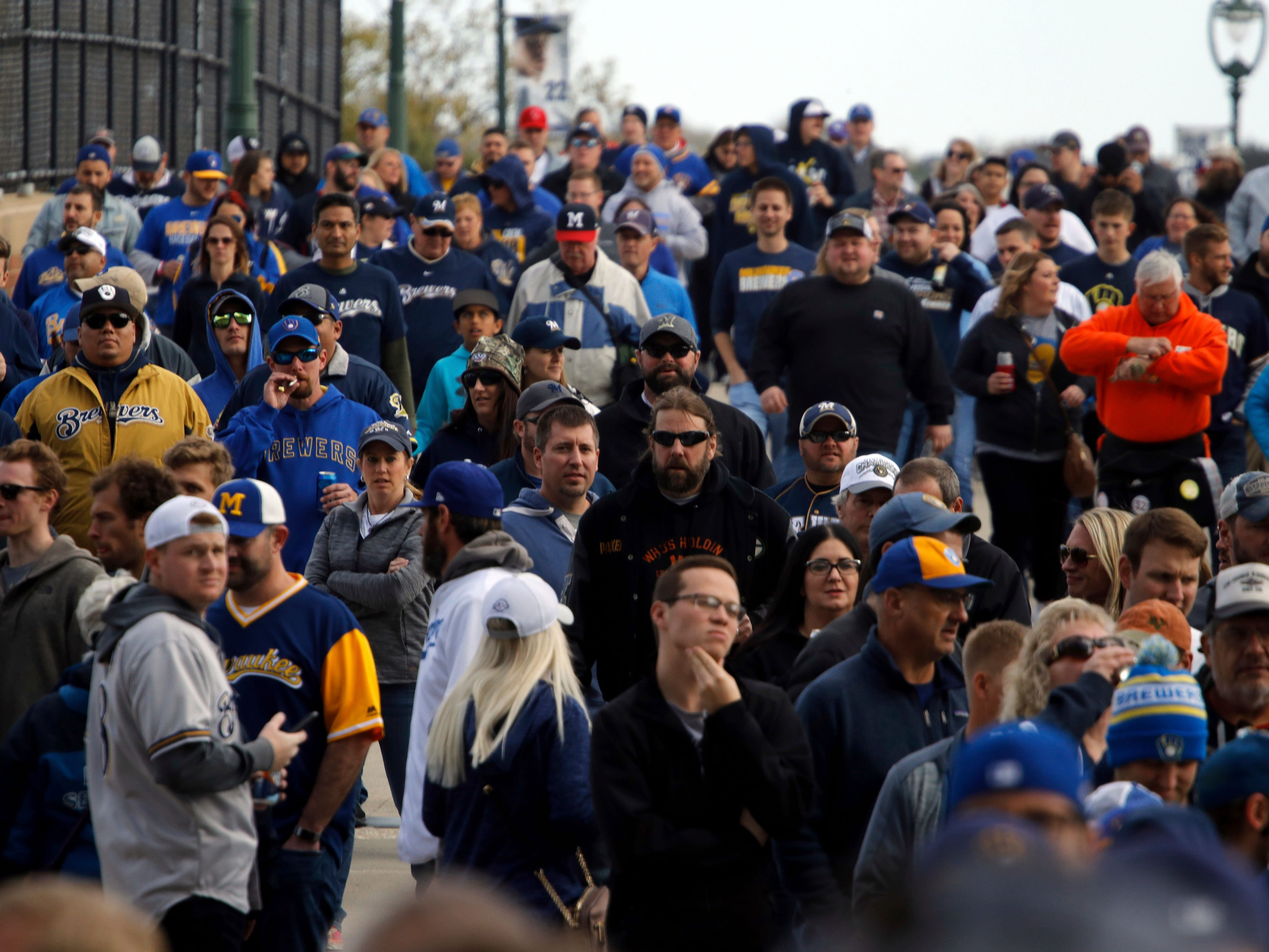 Fans arrive at Miller Park before Game 2 of the National League Championship Series baseball game between the Milwaukee Brewers and the Los Angeles Dodgers